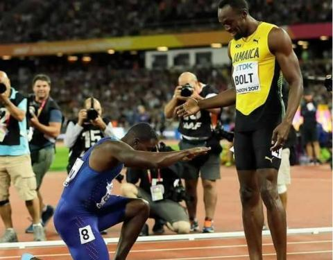 Justin Gatlin shows his respect to Usain Bolt after beating him