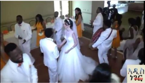 Bride and groom singing Ethiopian Orthodox Mezmur
