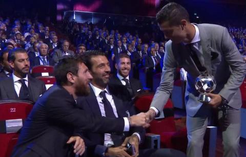 Lionel Messi congratulates Cristiano Ronaldo after winning