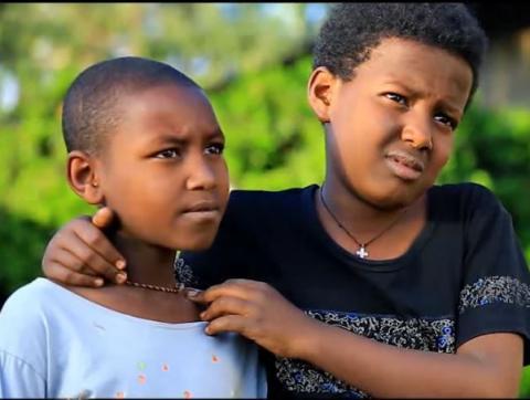 A scene from Yelij habtam film showing children working over time