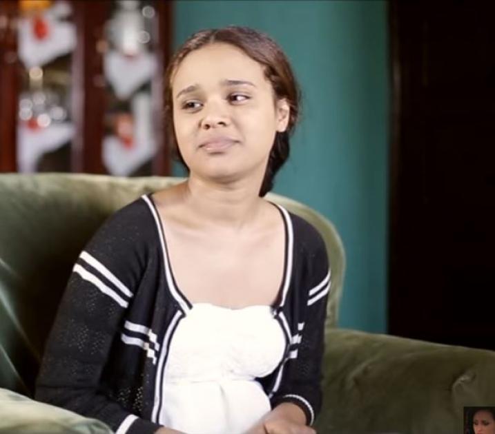 A girl explaining the meaning of true leadership and hero - Atse Mandela movie